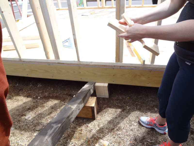 Using a lever to raise the structure in order to level it