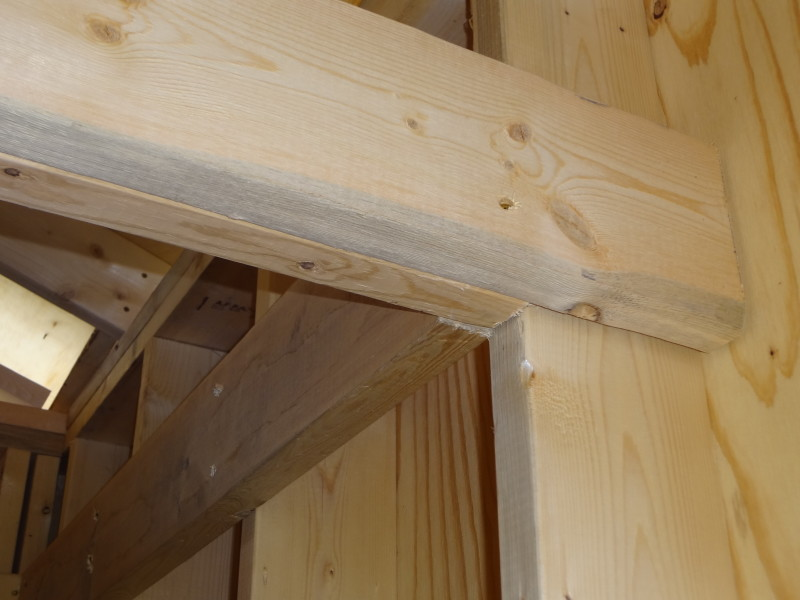 Detail view: additional 2x6 attached to loft and wall studs for support