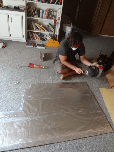 Lining cement board with aluminum foil (shiny side towards the fire)