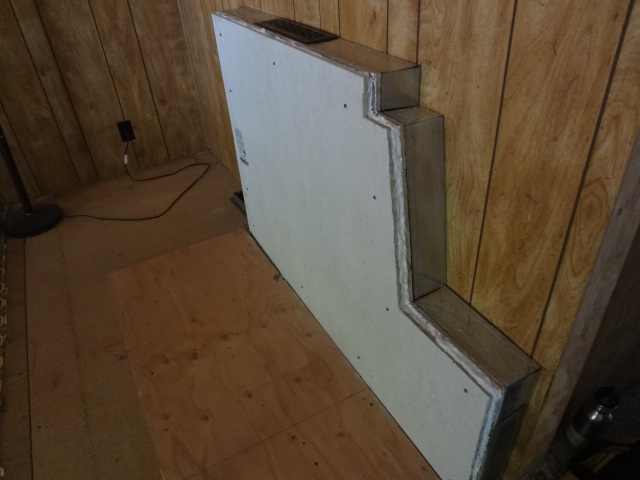 Empty metal box will provide air space between stove and wall. The front of the box is made of two layers of cement board lined with foil, with a sheet of ceramic wool between them.