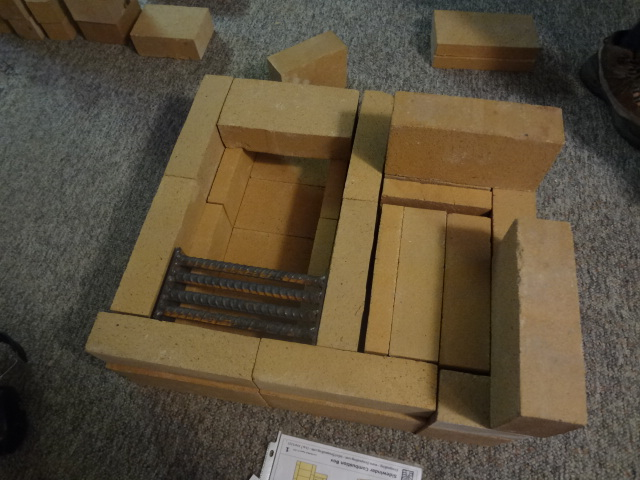 Layer 2, with ash grate (still needs two bricks in front of ash grate. Also, the two bricks on the right, laying on their narrow sides, are part of layer 3)