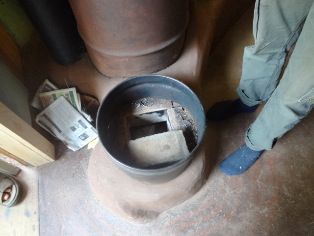 Wood for the fire is fed vertically in the small barrel