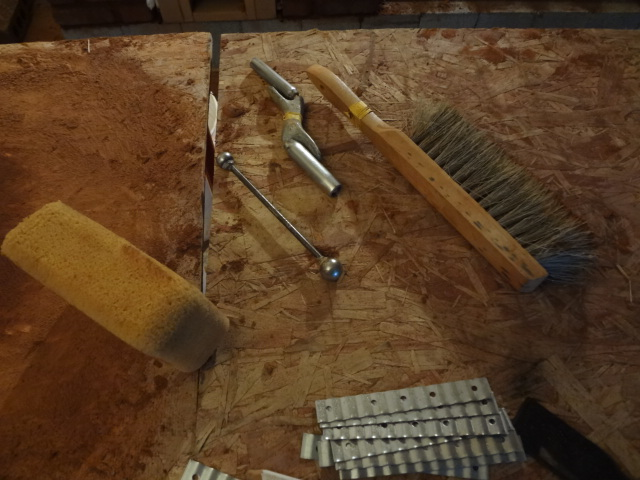 "Tools for ""striking"" the mortar joints between the bricks."