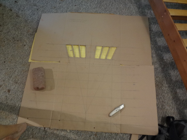 Cardboard sketch and cutouts of how the bricks will be cut to form the jack arch.