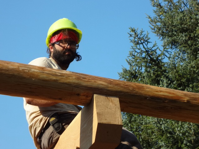 After the scribed lines are cut, Justin and the rafter sit nicely on the beam.