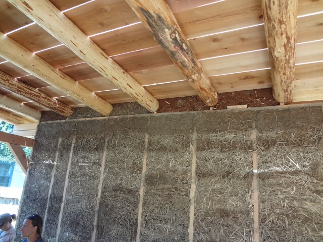 We filled in the areas above the wall, in between the rafters, with various materials - clay straw,  cob, straw, bottles.