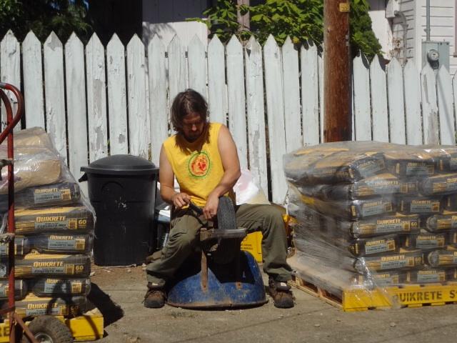 Keeping the equipment running : Pumping up the wheelbarrow tire
