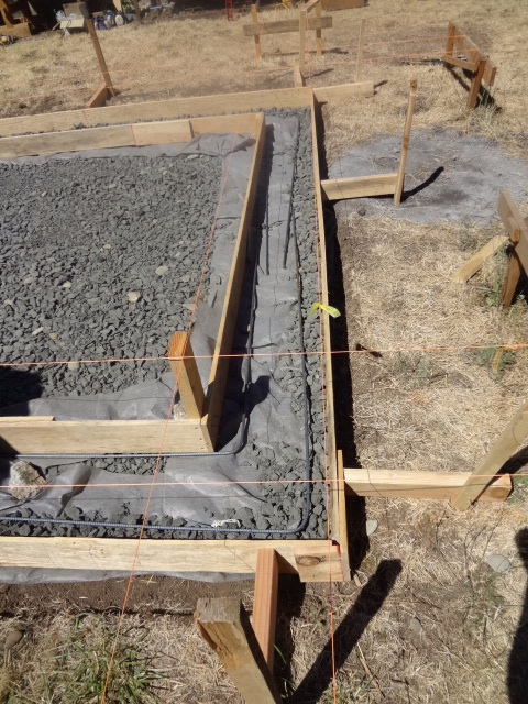 Laying rebar between the forms. Note overlap of several feet between ends.