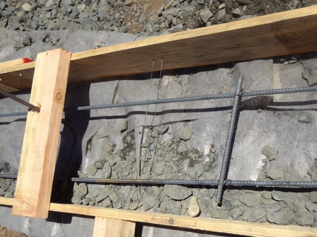Every 4ft or so (?), additional small horizontal rebar placed perpendicularly. These are also tied together with wire.