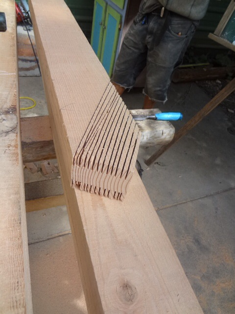 Slices made with circular saw in order to clear away material to create the tenon