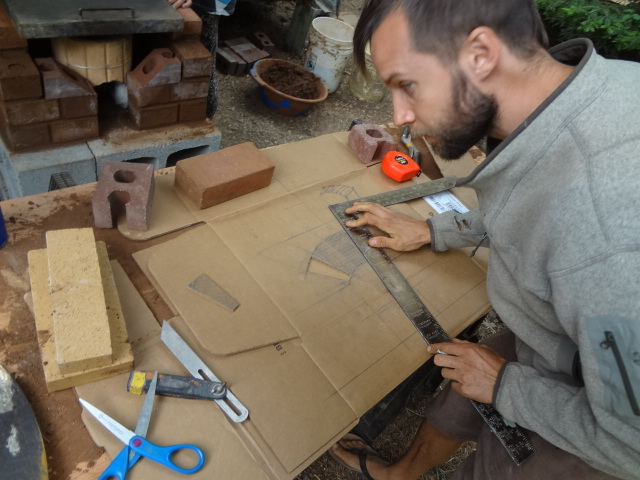 Drawing out and cutting the cardboard forms for the arch