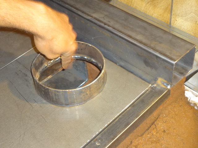 Installing the right portion of the stovetop which includes a hole for the chimney